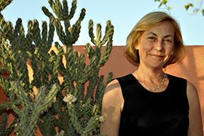 Caralyn Lawson in front of a cactus